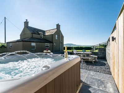 Photo for This secluded, detached farmhouse enjoys magnificent views of the Llyn Peninsula, all the way to the