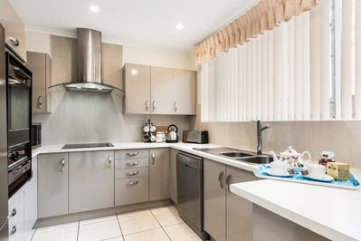 Bright open kitchen with all modern facilities to enjoy your stay.