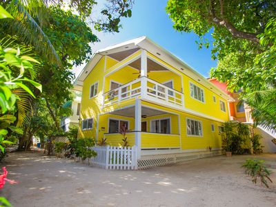 Photo for Oceanview beach house, dual-masters, roof top deck on West Bay Beach.