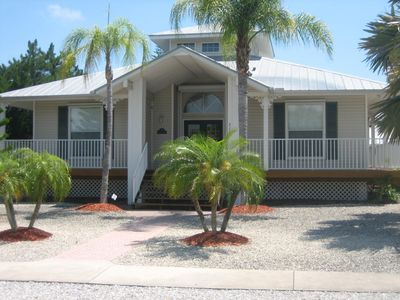 Photo for Key West Style Florida Charm with Heated Private Salt Pool 5 minutes from beach