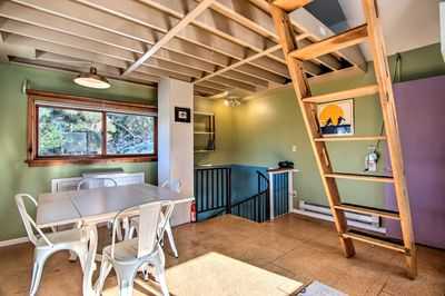 Head upstairs to access the open kitchen and dining area.