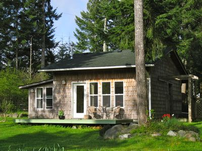 A pastoral guest cottage nestled in the fir-wood