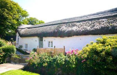 Photo for Putsborough Manor Barn (Sleeps 4 + cot) Tennis Dogs Full Sky Jacuzzi BBQ Beach