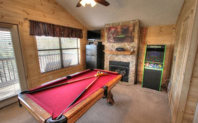 Game room with pool table, air hockey and multi-cade.
