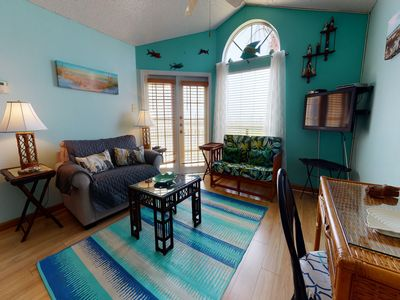 Photo for NEW LISTING! Beautiful condo w/ shared pool, hot tub, & gym - walk to the beach
