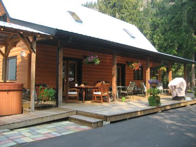 Spacious deck, hot tub and patio area......