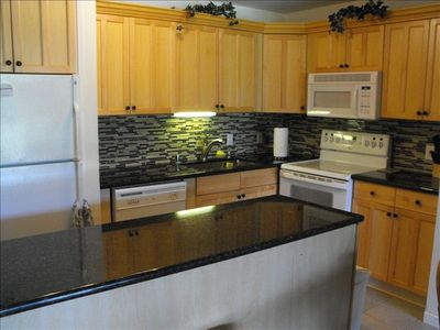 Updated Kitchen With Granite Counter Top