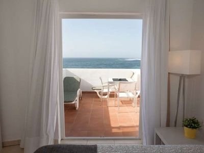 Photo for Apartment ONZISPOT 5 in La Santa for 2 persons with terrace, garden, balcony, views to the ocean, views of the volcanoes, WIFI and less than 10m to the sea