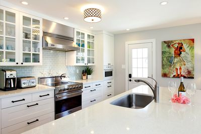Modern kitchen with Viking range and quartz counters