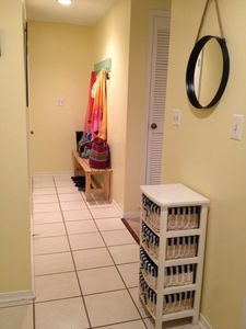 Entry way with bench and hooks for towels, beachbags, and shoes.