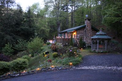 The Mountain Retreat...A view at dusk...with landscape lighting and room for 2+ cars
