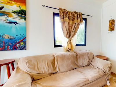 Upper-level resort suite with lovely views, shared grill, & nearby beach!