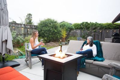 Take the blankets outside to the fire table. Party lights & comfortable seating