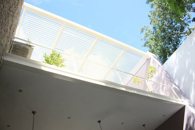 Looking up from the pool to the upper terrace