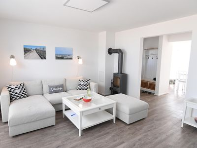 Photo for Spacious maisonette holiday home in first row to the water - all day sun - panoramic water view - two terraces - woodburning stove, sauna and whirlpool - modern country house style