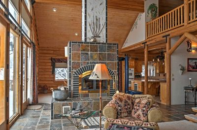 Cozy up in this cabin-like home featuring rustic decor.