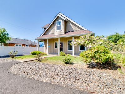 Photo for Adorable home w/ patio & firepit - less than a block to the beach!