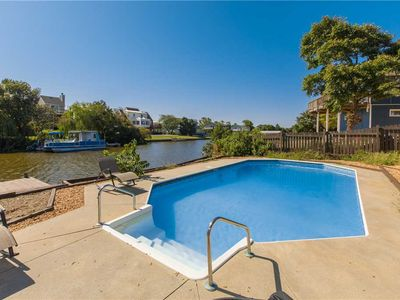 Photo for Classic dog friendly beach cottage on the canal with private pool, hot tub, & dock