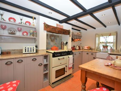 Lovely country kitchen with a feature Aga style oven and hob