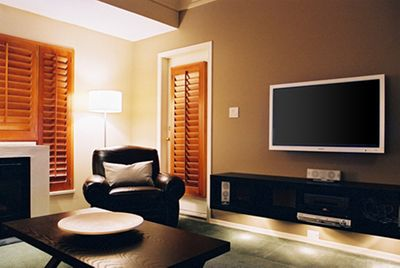 Comfortable living area with fireplace, flat screen TV and balcony