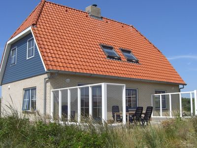 Photo for Luxurious holiday home in the dunes, at just 100 metres from the beach of Vlieland