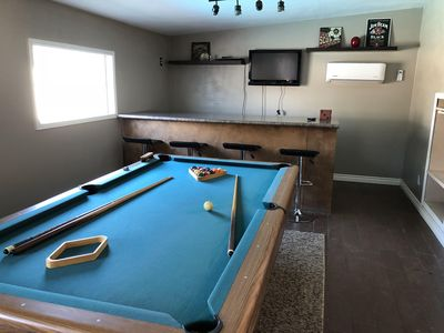 Billiards and a bar in the arizona room.