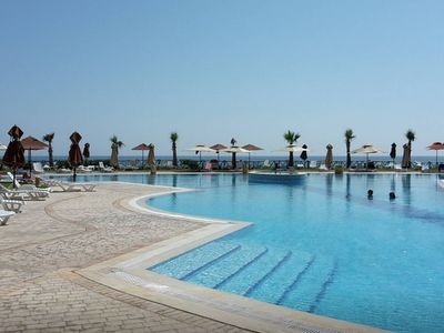 Photo for Seaside apartment FOLLA Resort with private beach