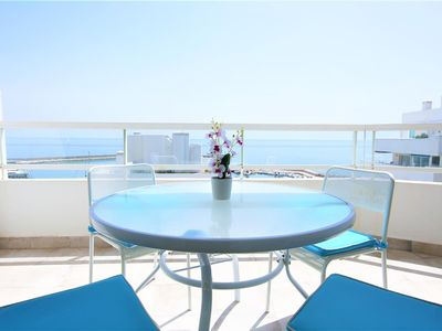 Photo for Seafront penthouse with roof garden, TV & air con, Front line Estepona marina close to shops and bar