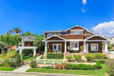 The beautiful Craftsman style home is located 150 yards from the sand.