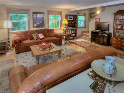 The cozy living room includes a gas fireplace and tasteful furnishings.