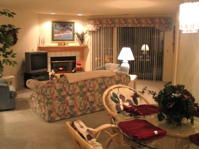 View of 2 bdrm Luxury Dining Room and Living Room with 42 inch Flat Screen TV.