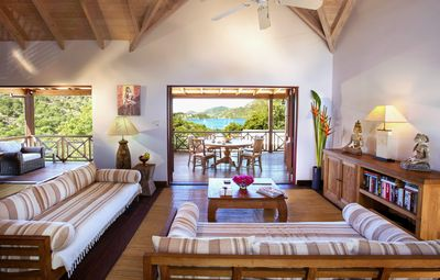 Main lounge with views over the entertainment space and the Caribbean Sea.