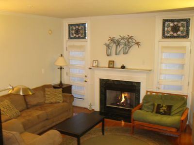 One side of the living room, with a gas fireplace. . .