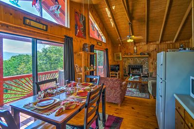The home's interior boasts vaulted ceilings, wood paneling, and hardwood floors.