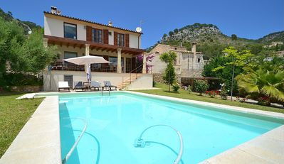 Photo for Beautiful town house with pool and panoramic views surrounded by countryside