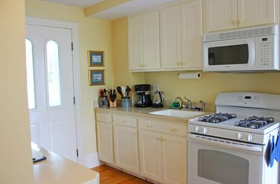 Well equipped kitchen opens to a covered porch