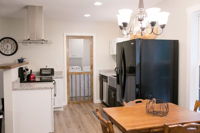 Kitchen with laundry area through screen door