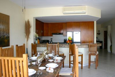 Extra large dining table comfortable for 6 persons. Additional seating for 4