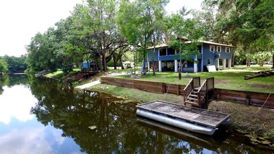 Photo for Fanning springs,with private concrete boat ramp,dock,hot tub,kayaks,peddle boats