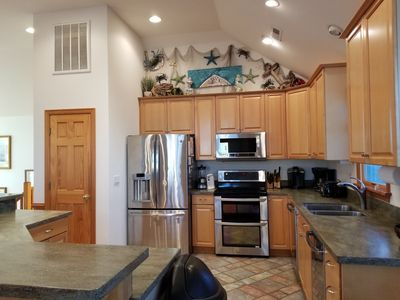 Photo for Brand NEW on VRBO- Beach home in gated community, 2 hot tubs, pool, billiards.