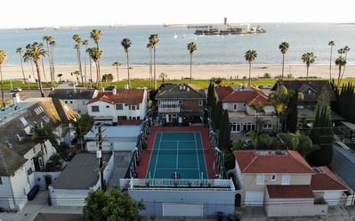 ISOLATE at OCEAN front private TENNIS court house.