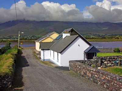 Photo for Detached cottage in fine location, at the end of the road right beside the pier, slipway and f…