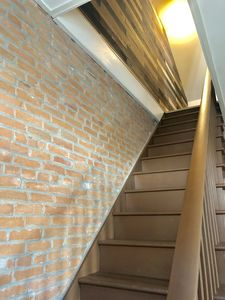 Stairway to the 2 cozy bedrooms