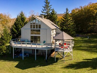 Photo for Unique Yankee Cabin with Sweeping Views! Private Pond, Multiple Lake access, Hot tub, Rec Room
