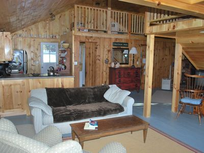 Photo for Beautiful lakefront cabin with private beach in secluded cove - Sunrise Lake