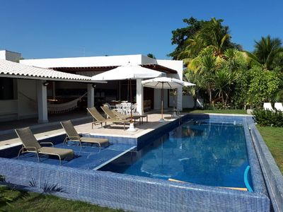 Photo for Comfortable House Guarajuba Oceanfront 5/4. 20 beds. Contact us!