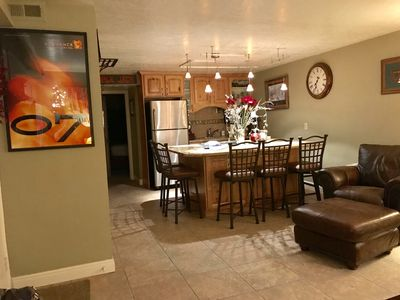 Large kitchen with huge granite countertop accommodating 7 and fully equipped.