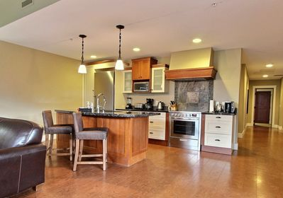 Gourmet kitchen with stainless steel appliances and granite countertops