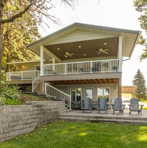 Lake View with three doors leading to the yard!  Relax in the adirondack chairs.