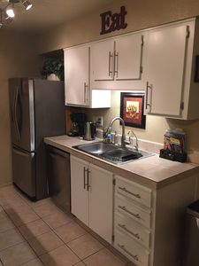 Kitchen with Stainless steel Appliances w/ dishwasher, filtered water on fridge